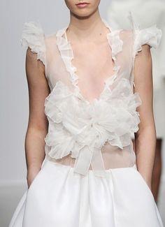 Twhite ruffled blouse
