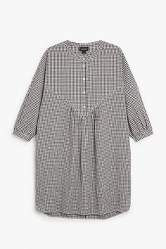 With a V-shaped seam across the front and tunic style collar, this gorgeous oversizeddress hits just below the knees and the sleeves end in a slight…
