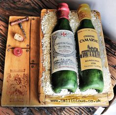 #WineBottlesCake #WineBottles #WineCake all handmade, hand sculpted wine bottles cake and crate. Sawdust is white chocolate .. Labels are hand made and hand painted board is hand painted. Corkscrew etc all hand made and all edible. #CalliciousCakes