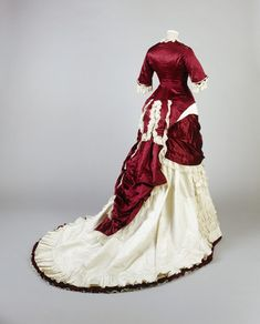 Deep red silk and ivory grosgrain princess-line evening dress with ivory machine lace and pleated cream silk satin trimming (back), 1874-79.