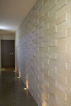 Lobby Conference Wall - Island Stone VTile II Cladding Series tropical White with smooth finish 2x16 stacked without joints
