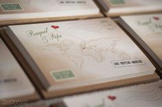 Vintage travel-themed wedding invitations with a map to pinpoint your Love's journey around the world.