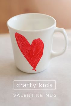 a painting project for kids for valentine's day - we used mugs from goodwill making this craft a lesson in recycling/reusing too!