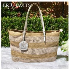 "ERIC JAVITS SQUISHEE SILVER & TAN TOTE BAG Eric Javits Beige Jav is the ""go to"" for summer totes! Features metallic-threaded squishee, silver hardware, metal feet, metallic leather trim, flat adjustable shoulder straps (est 10""drop) & ext pocket. Zip-top opening, magnetic snap closure. Inside, an interior zip pocket, 5 open pockets, leashed key clip & fabulous coral fabric lining. Approx: 12""h x 16""w x 4 1/2""d; weighs 2lbs. Imported. Color: Frost/White. Happy Poshing! Condition: Excellent…"