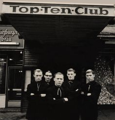 """The Monks in front of the Top Ten Club in Hamburg, Germany  Third Man Records have announced an amazing upcoming release: Five tracks recorded by fabled mid-60s avant-garage punks The Monks (often stylized as just 'monks') around the same time as their final single """"Love Can Tame The Wild"""" in early 1967. The lead-off number """"I'm Watching You"""" gets its world premiere here today, courtesy of the label.  The other four tracks on the Hamburg Recordings, 1967 EP were laid down at a studio…"""