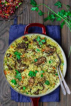 Middle Eastern Chicken and Rice   The Mediterranean Dish. Simple, comforting, one-pot chicken and rice dinner with a tasty Middle Eastern twist. Flavor heaven! Comes together in 30 minutes. Recipe from TheMediterraneanDish.com #mediterraneandiet #middleeasternfood #chickenthighs #onepot #easydinner #healthyrecipes #glutenfree