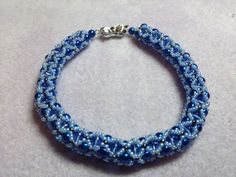 Blue pearl & bicone. Thanks go to Beading for perfectionists.