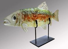 Title:  Rainbow Trout  Technique:  Colored w/ Glass, Fused, Slumped in Kiln. Can also be mounted to wall.  Artist:  LK Hawks  Two Sizes: Large 26