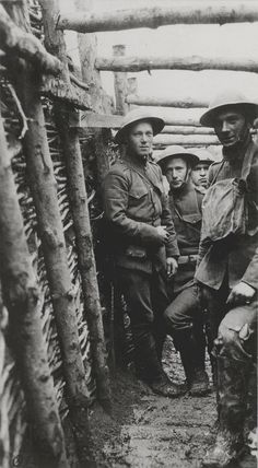 US Marines in a muddy trench on the front, c. 1918