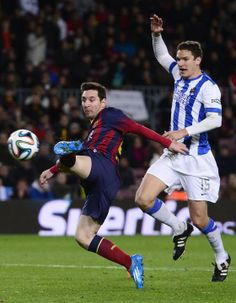FC Barcelona's Lionel Messi, from Argentina, left, duels for the ball against Real Sociedad's Ion Ansotegi during a Copa del Rey soc...