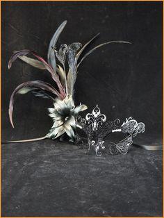 fabulous idea, adding feathers to a metal filigree mask