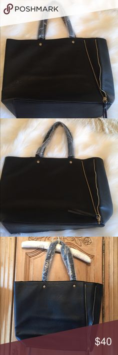 Neiman Marcus Tote Black Tote never carried! Zippers on both sides! Super cute! Neiman Marcus Bags Totes