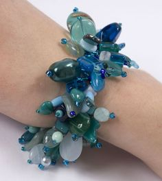 Seascape Bracelet  Great Instructions. made with thread not Wire !   I just might try this!!