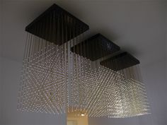 'swarm light', 2010  LEDs, polished brass rods, custom circuit boards, custom driver software and hardware, behavioural algorithm, sound / motion sensors, computer & interface  3 cubes of 810 x 810 mm