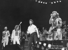 The Bee Gees on stage with John Travolta