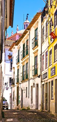 The colourful narrow streets of the old town #Coimbra, #Portugal.Photo by MaritaToftgard