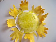Simple weather craft for kids - Paper Plate Sun with Handprints #preschool #kidscrafts #efl #education (pinned by Super Simple Songs)