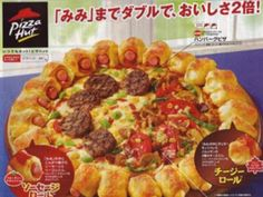 So in New York They are fighting over the ban of super size drinks.. And over seas they are eating stuff like this. Mini bacon-wrapped hotdogs surround a cheesy center topped with mini hamburgers, peppers, mushrooms, and onions on this Pizza Hut creation.