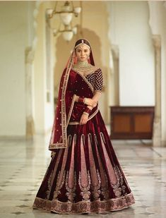 The lehenga made in velvet with thread embroidery. with designer blouse and dupatta. if you need stitching service or else we send unstitched. Latest Bridal Lehenga, Latest Bridal Dresses, Indian Bridal Lehenga, Red Lehenga, Lehenga Choli, Latest Lehnga Designs, Wedding Lehenga Designs, Indian Bridal Photos, Indian Bridal Outfits