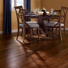 Global style comes home to roost in Mayan Pecan hardwoods, an exotic species hand crafted with a soft scrape and unique staining process that yields board-to-board variations and real visual depth.