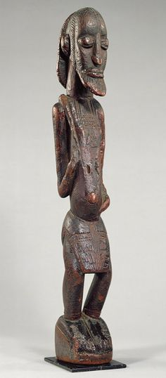 Dogon (or Tellem?) standing male figure (contemporaneous and stylistically similar to Inland Niger Delta works), Western Sudan, c.12th-17th century (wood)