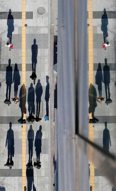 Pedestrians cast shadows on the pavement near the headquarters of the Bank of Japan in Tokyo, pic: Reuters/Kim Kyung-Hoon