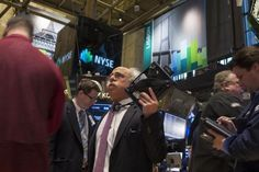 Traders work on the floor of the New York Stock Exchange (NYSE) February 10, 2014.   REUTERS-Brendan McDermid