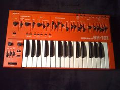 Bright ORANGE Roland synthesizer omgosh! YES. I would love to play this baby