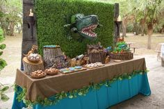 The dessert table at this Jurassic World Birthday Party will blow your mind! Absolutely love the backdrop. What a great idea!! See more party ideas at CatchMyParty.com