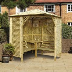 A great corner garden arbour from Gardensite. #arbour #gardendesign #garden