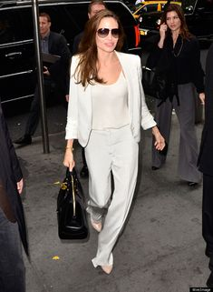 Angelina Jolie in White Blazer and white wide trousers  #celebrity #fashion #style