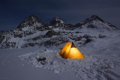 Winter camping on Hurricane Pass. In the background are the Grand Teton, Middle Teton, and South Teton. Wyoming.