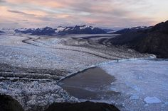 Photo by @james_balog. Columbia Glacier descends from an ice field 3050 meters above sea level down the flanks of the Chugach Mountains and into a narrow inlet that leads into Prince William Sound in southeastern Alaska. It is one of the most rapidly changing glaciers in the world. Since the 1980s the glacier's terminus has retreated some 12 miles and thinned substantially losing about half of its thickness and volume. Follow @james_balog for more images of disappearing glaciers…