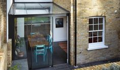 Adding a modern glass extension to a listed Georgian house in an East London conservation area