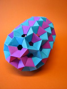 Modular Origami: a giant short nanotube In modular origami, multiple geometric modules, each made from a single sheet of paper, are combined to form more complex models. Origami Modular, Geometric Origami, Origami Paper Folding, Origami Star Box, Origami And Kirigami, Origami Ball, Origami Love, Origami Fish, Origami Design