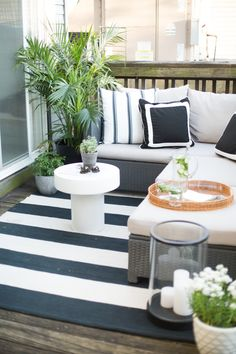 Black + white striped deck area: http://www.stylemepretty.com/living/2016/06/07/why-decorating-with-neutrals-will-never-ever-go-out-of-style/ | Photography : Danielle Moss - http://danielle-moss.com/