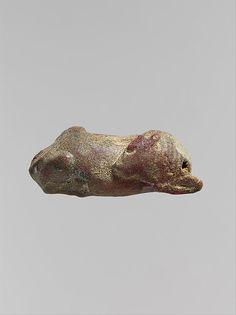 Pendant: recumbent bull Period: Classical Date: mid-5th century B.C. Culture: Italic or Etruscan Medium: Amber