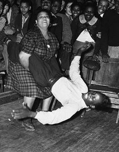 A woman swings her Lindy Hop partner by the legs during a Salvation Army benefit dance marathon in Los Angeles. December 12, 1939.