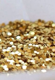 Gold confetti. Looks very festive when sprinkled on tables and counter-tops.
