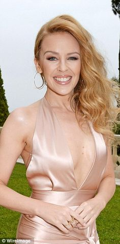 Smiley Minogue: Kylie looked simply stunning in her plunging gown...