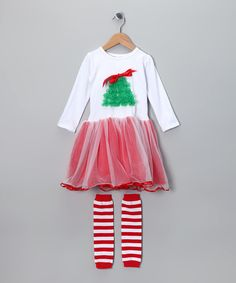 This festive set is picture-perfect from the ruffle Christmas tree on the top down to the soft, fluffy skirt and jolly stripe leg warmers. All these precious pieces need is a sweetheart to dance and prance inside their happy holiday seams.Includes dress and leg warmersTop: 100% cottonexclusive of decorationSkirt:100% nylonLeg warmers: 100% polyesterHand wash; hang dryImported