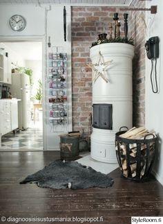 joulu,joulukoti,vintage,industrial,pönttöuuni,polttopuut,lehtiteline,tehdastyyli,työhuone