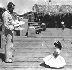 """Cary Grant on set of Operation Petticoat, 1959  """"A little girl got a small part in the movie but was very upset when she found out she had to wear rags. Apparently Cary heard about it and bought her a little pink dress."""""""