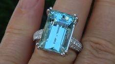 A Gorgeous GIA Certified 12.47 Carat Aquamarine & Diamond Cocktail Ring. This Absolutely Colossal Natural Aquamarine features gorgeous near perfect INTERNALLY FLAWLESS clarity and a rich and stunning Greenish Blue color. This jaw dropping estate treasure features a solid 14k white gold setting that is elegantly set with an impressive 42 diamonds with VS1-SI2 clarity and near colorless G color, accenting this eye caching custom made designer estate ring…making this one of a kind designer…