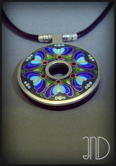 """Silver pendant inspired by Kashubian embroidery(folklore of north Poland). Pendant is made of combining fine silver and ebony wood. Decorated with enamel cloisonne, unique technique of """"minankari"""". www.facebook.com/ANDcli"""