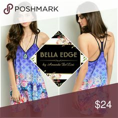 Purple floral abstract dress 100% POLYESTER. Abstract purple mini/above knee dress with honeycomb-like pattern with bold and bright floral print adorning the bottom half of the dress. Black lining, double Y strap/backing. Sizes small to large.  Ships Thursday 7/8 Bella Edge Boutique  Dresses