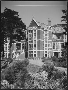 Exterior view of Mr Hope Gibbons' house at Lyall Bay, Wellington, taken ca 1930 for The Dominion Quantity: 1 b&w original negative(s). Wellington New Zealand, Tudor Style, British Isles, Natural History, Homesteading, Exterior, Mansions, Architecture, Building