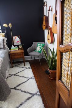 Black walls from Lesley Graham: Room Tour: Our Bedroom Home Bedroom, Home Living Room, Bedroom Wall, Bedroom Decor, Studio Living, Bedroom Inspo, Wall Decor, Guitar Room, Guitar Wall
