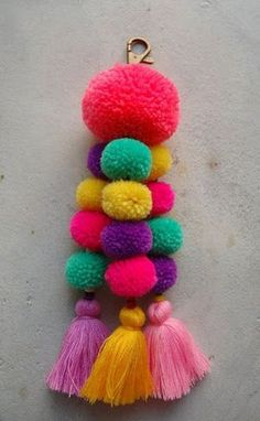 Pink Pom Pom Tassel Beach Bag Accessory by SiamHillTribes on Etsy: Diy Craft Projects, Diy And Crafts, Arts And Crafts, Diy Y Manualidades, Wool Dolls, Pom Pom Crafts, Handicraft, Tassels, Crochet Patterns