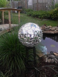 Our new gazing ball.... made from Kacie's Mom's bowling ball....and lots of cracked mirrors....   it is so Brilliant!!